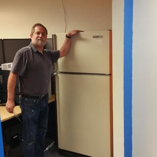 Kevin Jorgensen shows off the new IMR team fridge. 2016-04-20_08.42.57.jpg