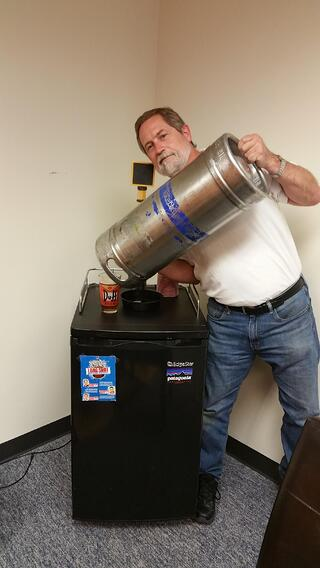 2016-05-06_Kevin_shows_that_we_have_kicked_the_first_keg_of_Sam_Adams_in_the_IMR_kegerator.jpg