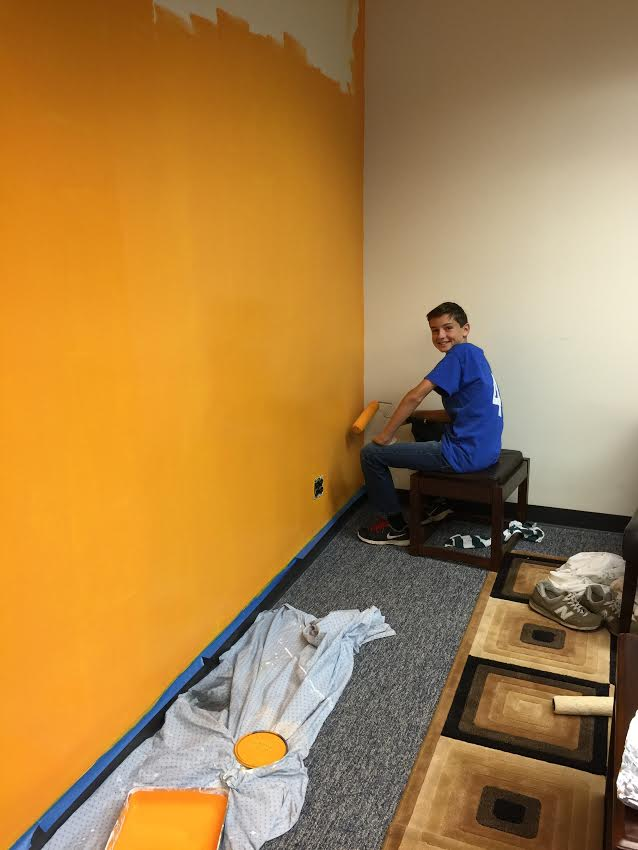 A_mini_Jorgensen_Alex_helping_us_paint_the_company_colors_during_Pimp_my_Office_on_11.14.15.jpg